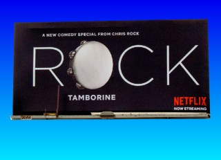 "The reveal billboard for Chris Rock's ""Tamborine"""