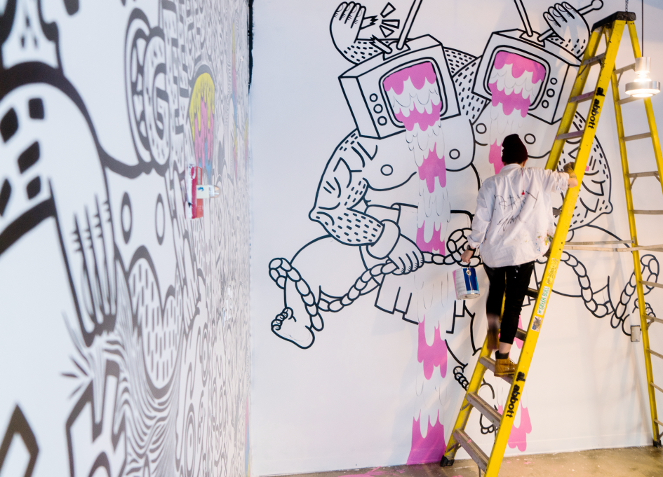 Artist Lauren Asta at work in Havas lobby