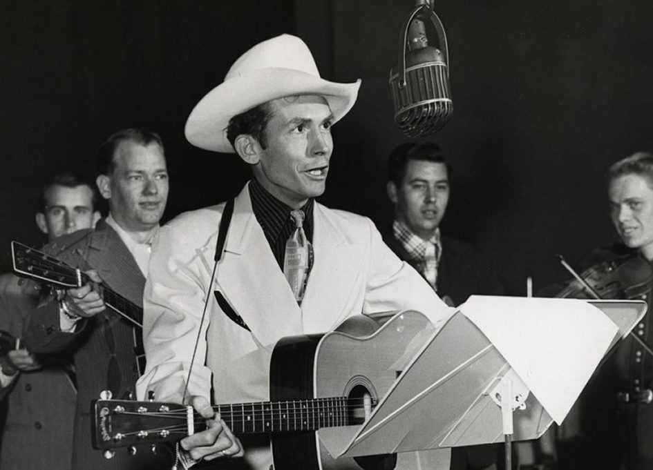 """Hank Williams with band performing on WSM radio's """"Grand Ole Opry."""" Nashville, Tennessee, 1951"""