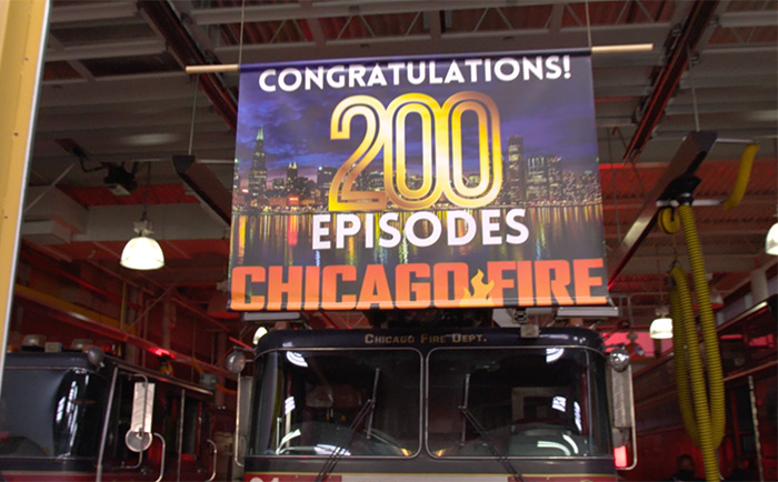 On set with cast and crew as Chicago Fire celebrates their 200th