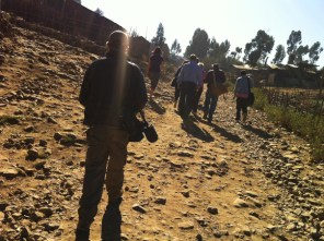 LUCIA move through a village, visiting the projects they support