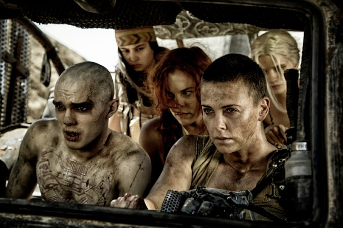 """(L-r) NICHOLAS HOULT as Nux, COURTNEY EATON as Fragile, RILEY KEOUGH as Capable, CHARLIZE THERON as Furiosa and ABBEY LEE KERSHAW as Wag in Warner Bros. Pictures' and Village Roadshow Pictures' action adventure """"MAD MAX: FURY ROAD,"""" a Warner Bros. Pictures release. Photo by Jasin Boland"""