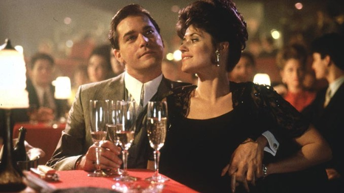 Ray Liotta as Henry Hill sitting with Lorraine Bracco as Karen Hill at nightclub.