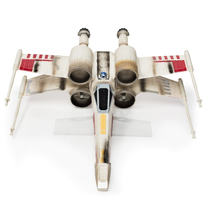 Star Wars Remote Controlled X-Wing Starfighter. .Licensee: Spinmaster.MSRP: $6.99.Available: September 4. .Take on the Empire with the real flying Remote Control X-Wing from Air Hogs! Fly into attack position as a Rebel Alliance pilot and experience the thrill of Star Wars outdoors! The X-Wing uses ducted propellers to power its flight letting you recreate your favorite scenes. The X-Wing Starfighter uses 2.4GHz communication for superior control and delivers a flying range of up to 250 feet away! Built from durable high-density foam, the X-Wing?s authentic design stands up against the toughest crash landings. Bring home the epic adventures of Star Wars and experience the thrill of outdoors Remote Control flight with the X-Wing Star Fighter From Air Hogs!