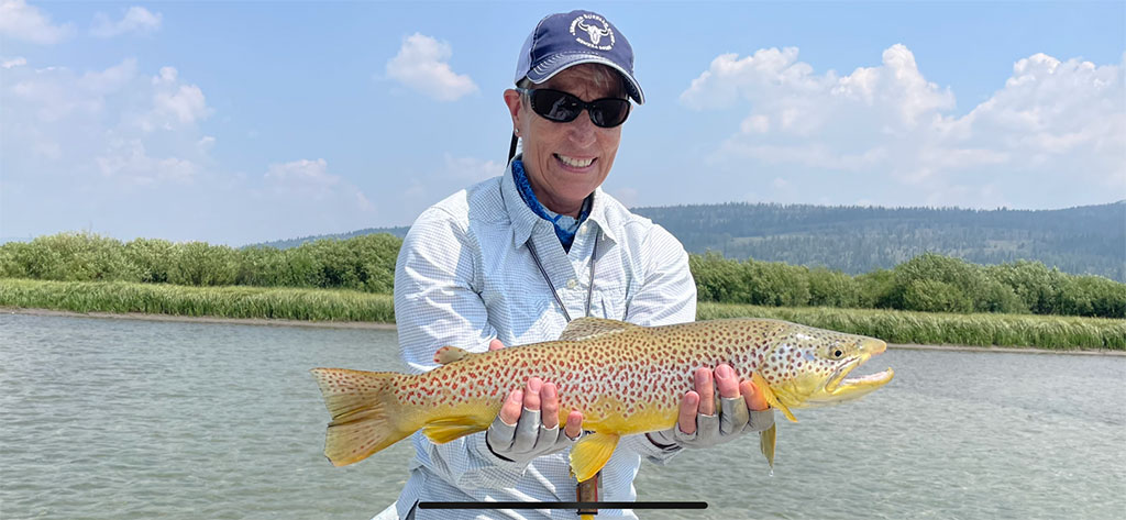 Reel Women Fly Fishing Adventures Green River, WY angler with brown Trout