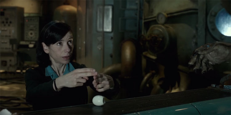 "Sally Hawkins signing ""egg"" to offscreen monster in the dim laboratory in The Shape of Water"