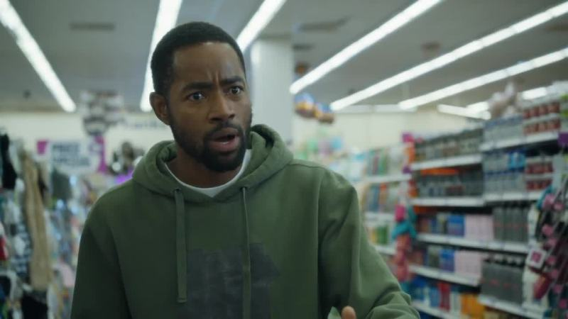 Lawrence from HBO's show Insecure is pictured reacting in a green hoodie.
