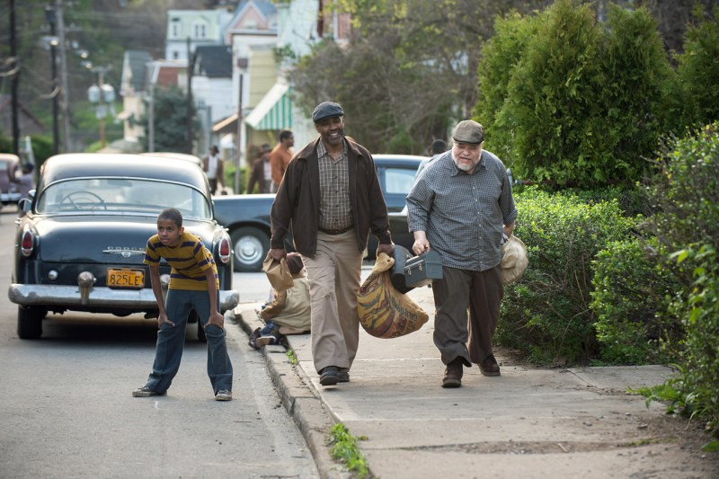 Troy and Bono walk home, in a scene from the 2016 Denzel Washington film, Fences, starring Denzel Washington, Viola Davis, Stephen Henderson and others.