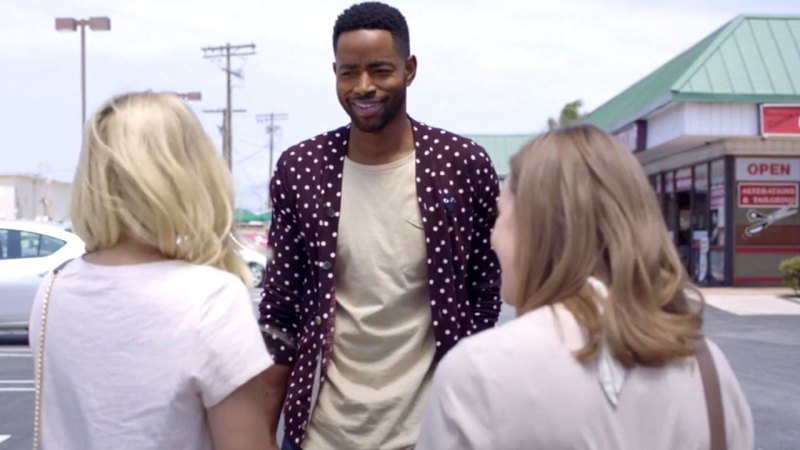Jay Ellis as Lawrence greeting two women in a parking lot in a scene from the 2017 HBO dramedy, Insecure.