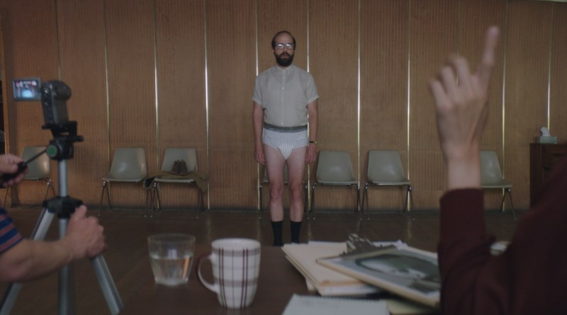 An image of Brett Gelman as Isaac standing in an adult diaper, in a scene from the 2017 dark comedy by Janicza Bravo, Lemon.