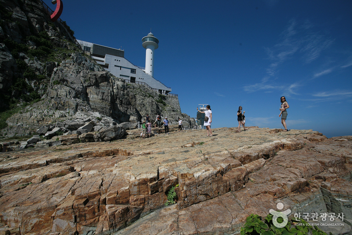 People standing near a lighthouse at Taejongdae, Busan.