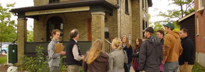 University of Waterloo students tour the outdoor features of REEP House