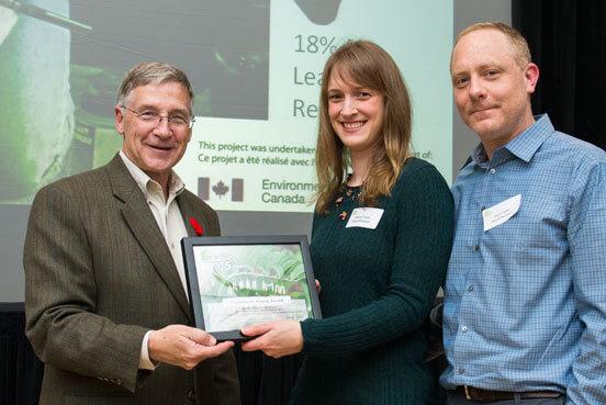 Regional Chair Ken Seiling presents Energy award to Kristina and Jason Taylor of Baden