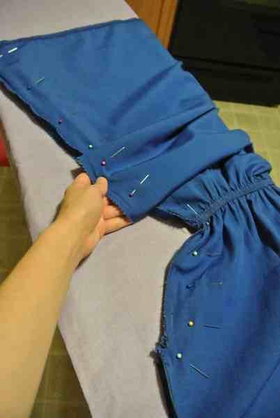 Pinning each side of dress