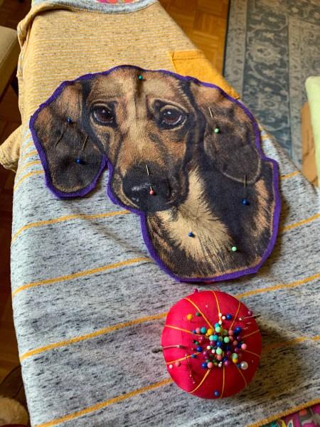 refashionista pinning dachshund appliqué to t-shirt