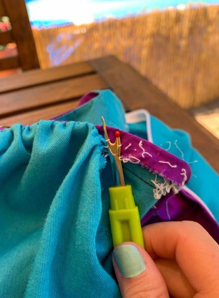 removing sleeves of muumuu with seam ripper