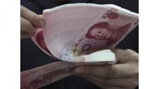 La banque centrale chinoise va relever pour la quatrième fois cette année le coefficient des réserves obligatoires des banques, de 50 points de base, poursuivant son tour de vis monétaire pour lutter contre l'inflation. Cette mesure, qui porte le ratio de réserves requises à un plus haut record de 20,5%, entrera en vigueur le 21 avril. /Photo d'archives/REUTERS  (c) Reuters