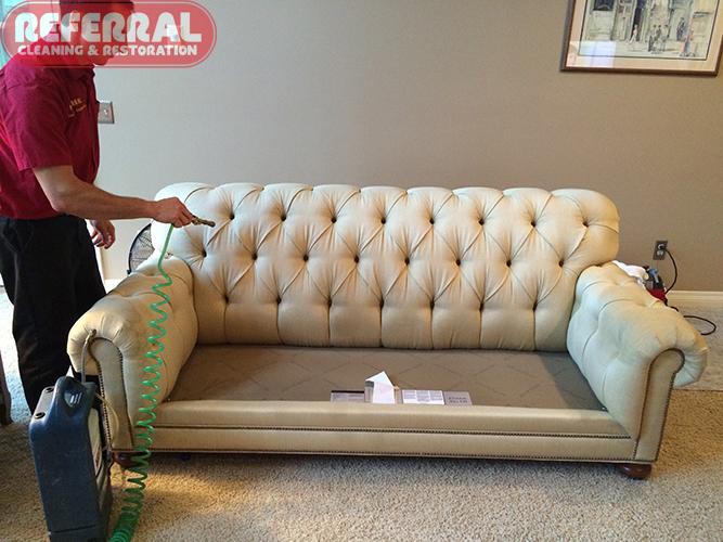 Scotchgard Applying Fabric Protector To A Sofa