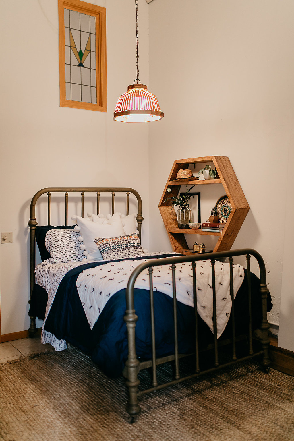 Vintage bed with a hexagon shelf
