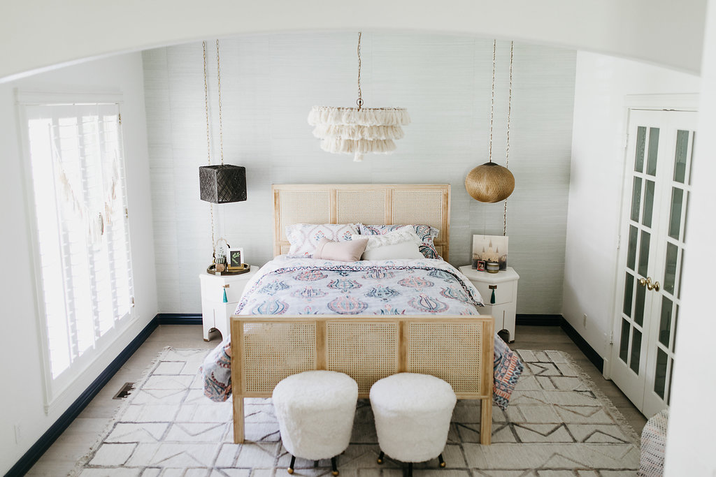 Chic girl's bedroom with fur footstools and hanging fixtures