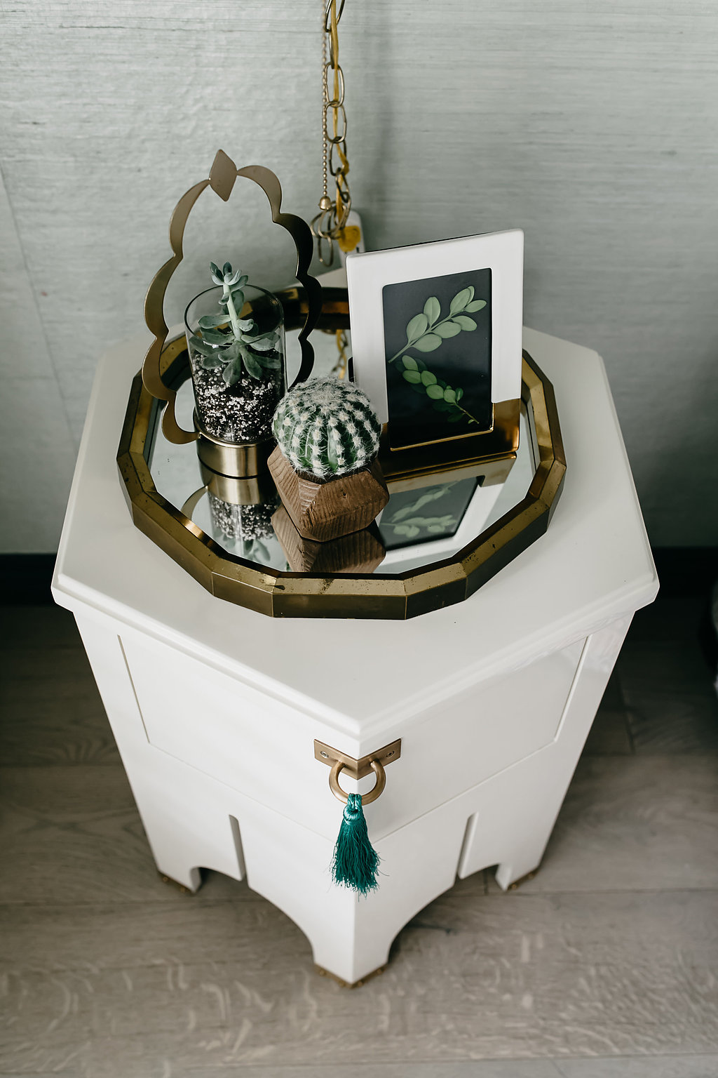 White nightstand with mirror and succulents