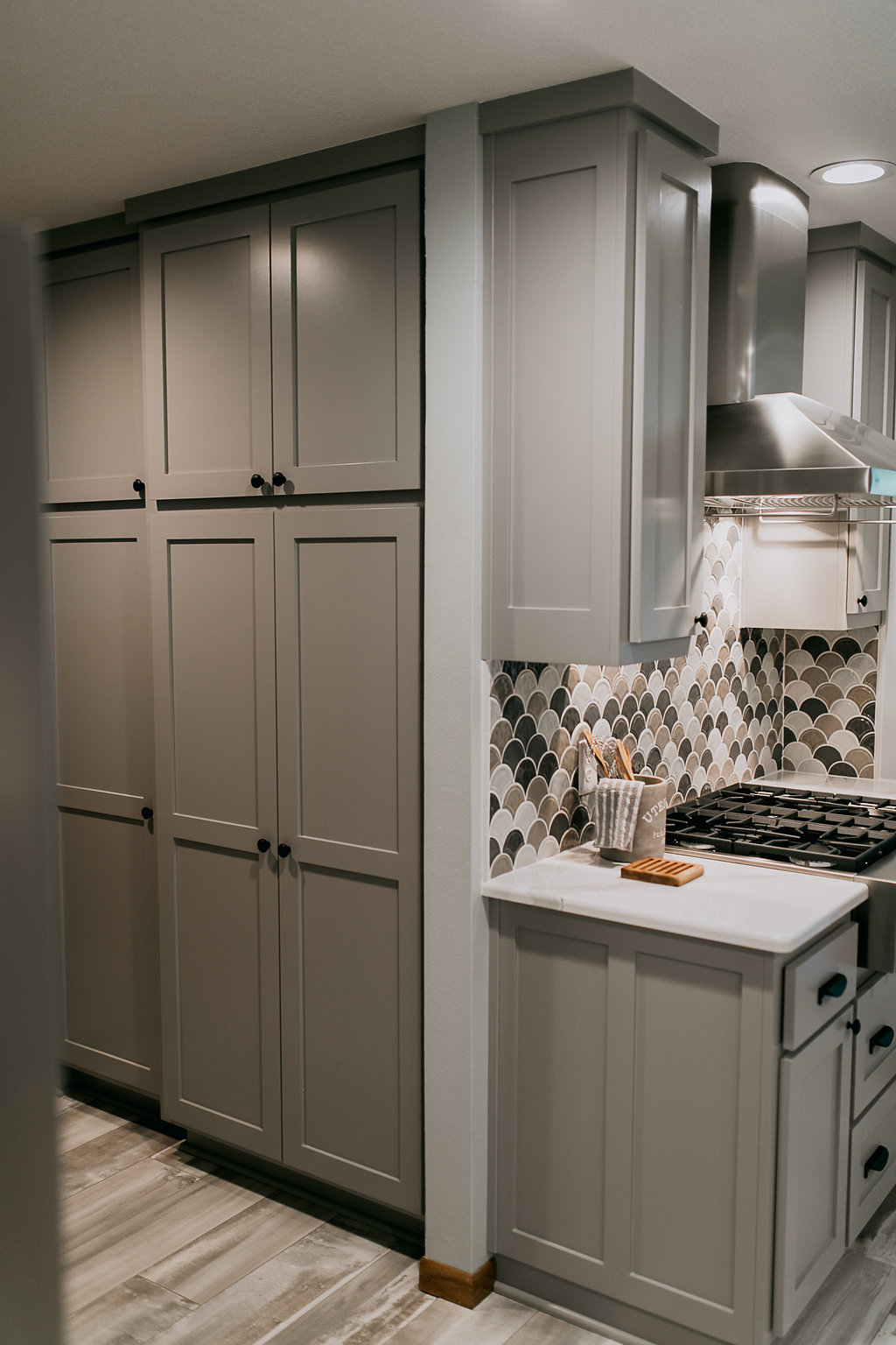 Grey cabinets, pantry, in contemporary kitchen