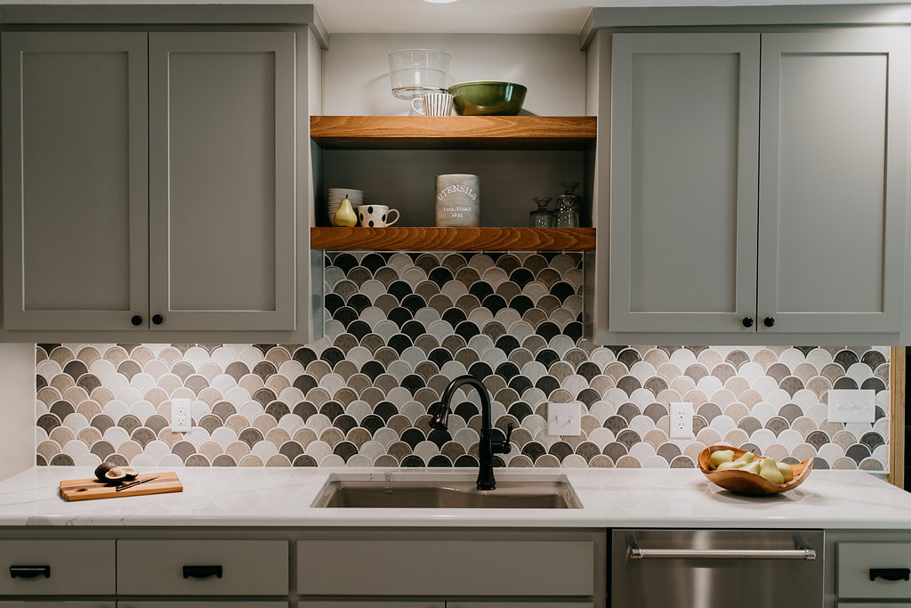 Grey contemporary kitchen sink and backsplash