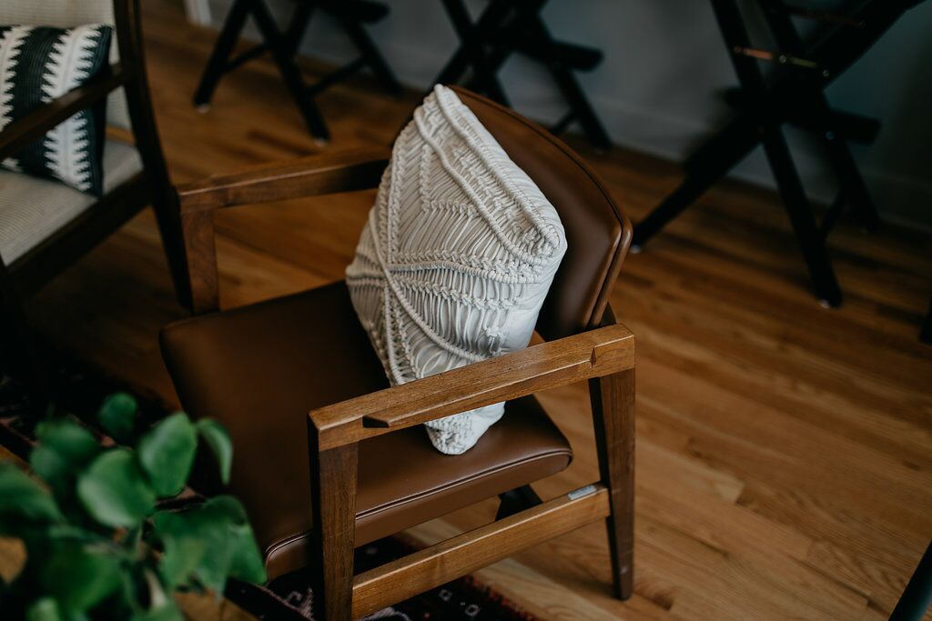 Wooden chair with woven white pillow