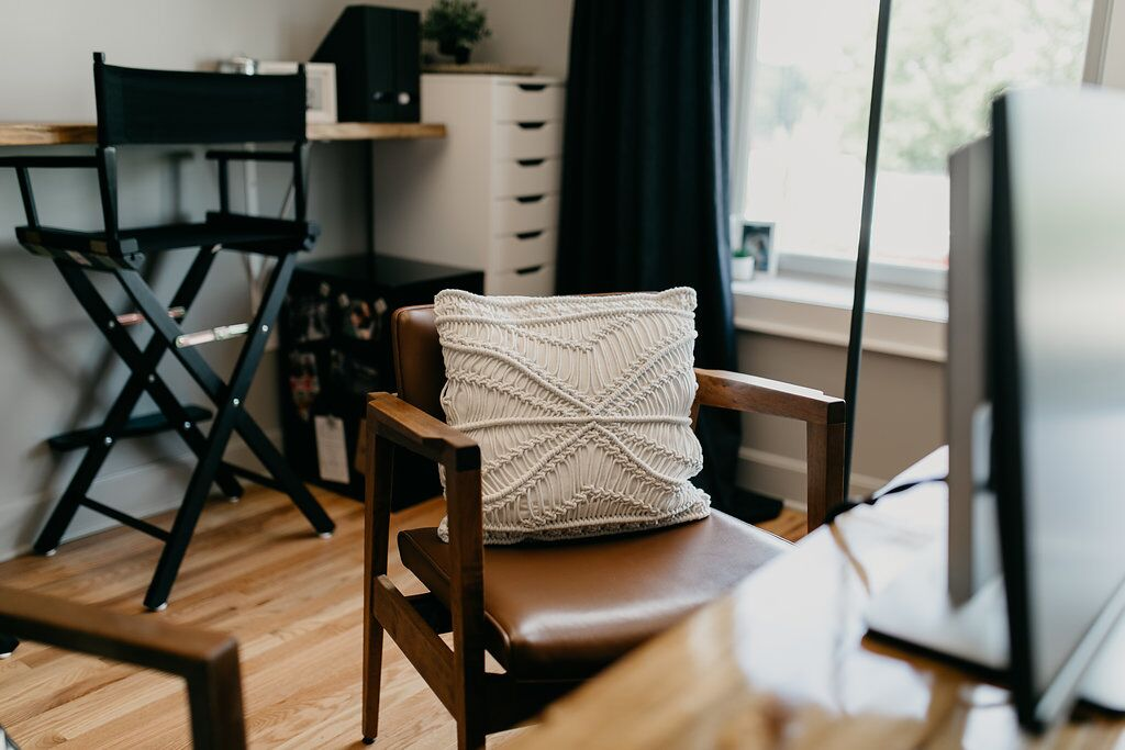 Wooden chair with white woven pillow
