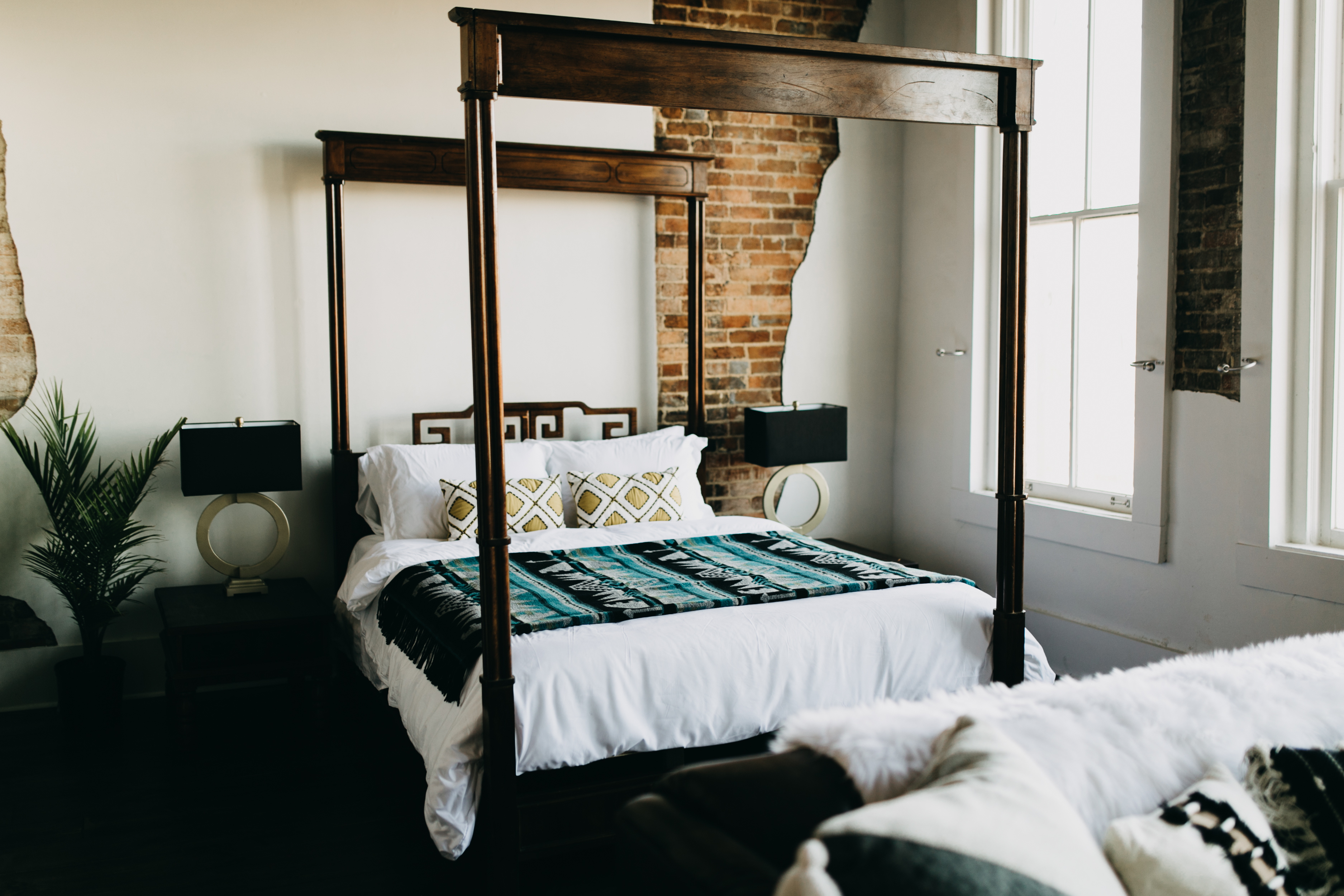 Springfield mo airbnb, Queen size wooden bed frame, teal and black aztec blanket