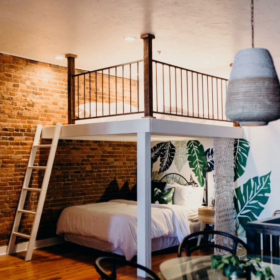 Two queen bed loft with ladder, tropical leaf mural, springfield airbnb