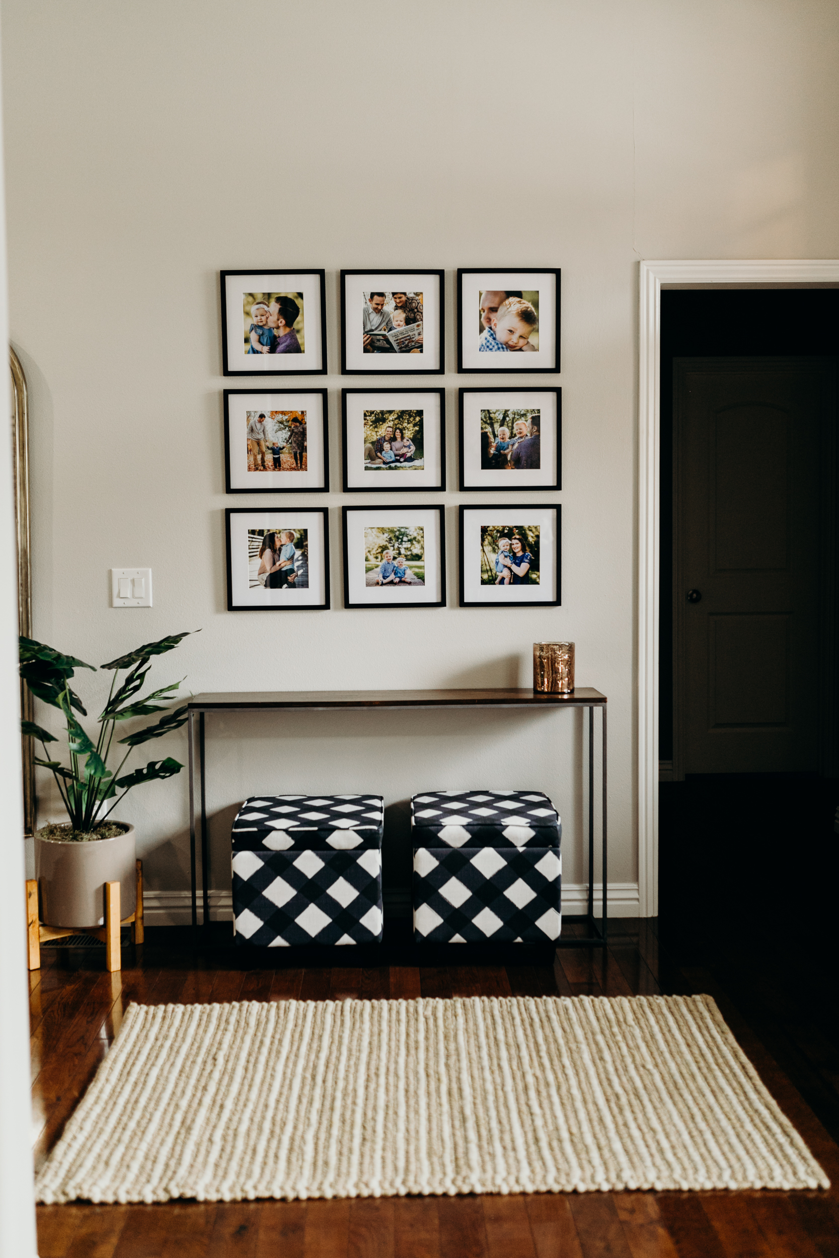 Square picture frames on wall with table and storage bins