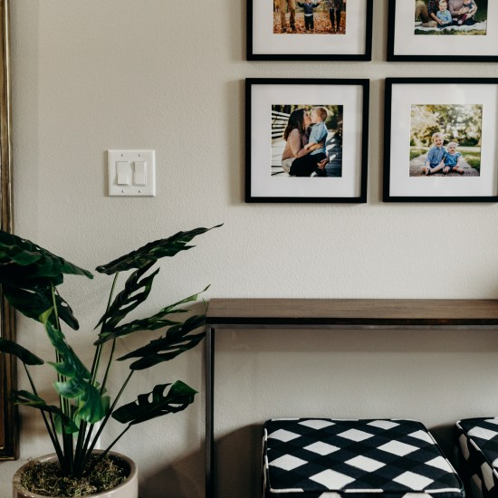 Small wooden table and picture frames