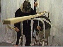 """albrecht/d. bei Performance """"und willst du nicht mein Bruder sein..."""" mit Franz Dreyer, Oberwelt e.V. Stuttgart 2001, Standbild der Videodoku von Mark-Steffen Bremer"""