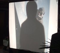 Buddhas Schatten über Astronaut bei reenactment einer Performance von albrecht/d. 1990 in Wien durch S.A.C. modellers club am 13. Januar 2016 im Württembergischen Kunstverein Stuttgart