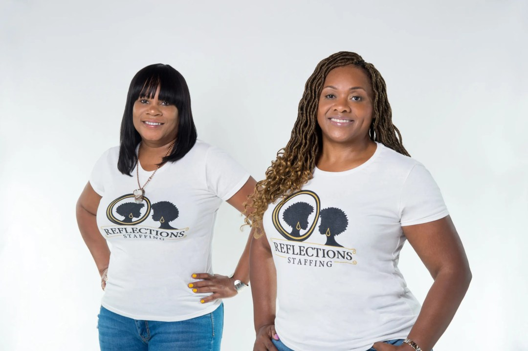 Photo of Sunnie and Michele wearing Reflections tee shirt.