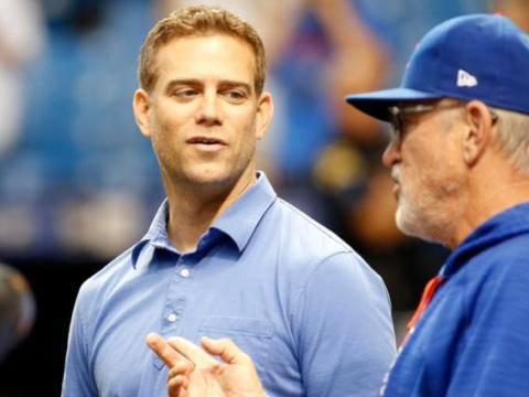 Theo Epstein chats with his manager, Joe Maddon. Mandatory Credit: Kim Klement-USA TODAY Sports