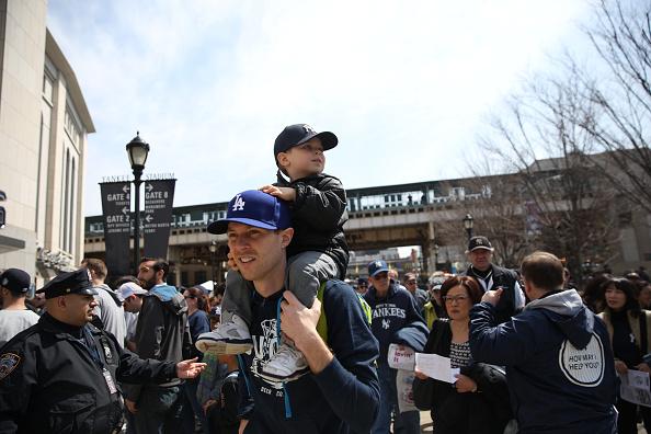 Fans arrive at Yankee Stadium before the New York Yankees Vs Toronto Blue Jays season opening day at Yankee Stadium, The Bronx, New York. 6th April 2015. Photo Tim Clayton (Photo by Tim Clayton/Corbis via Getty Images)