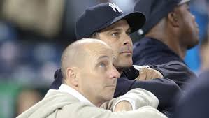 Yankees Puppeteer - Brian Cashman and his caddy Aaron Boone<a rel=