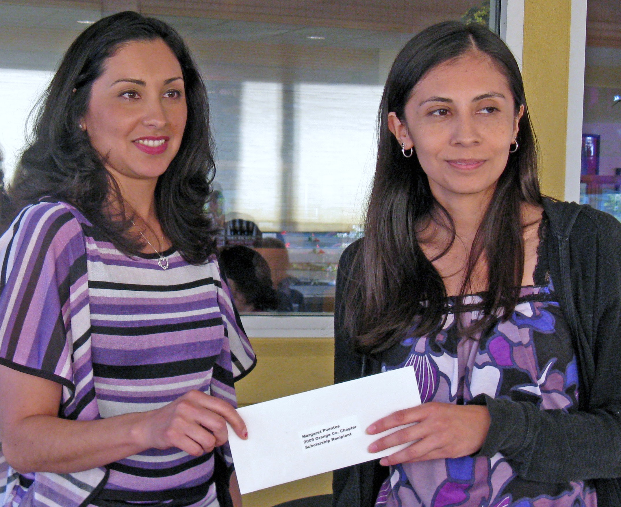Patty Lopez presents check to 2009 Chapter Scholarship recipient, Margaret Puentes