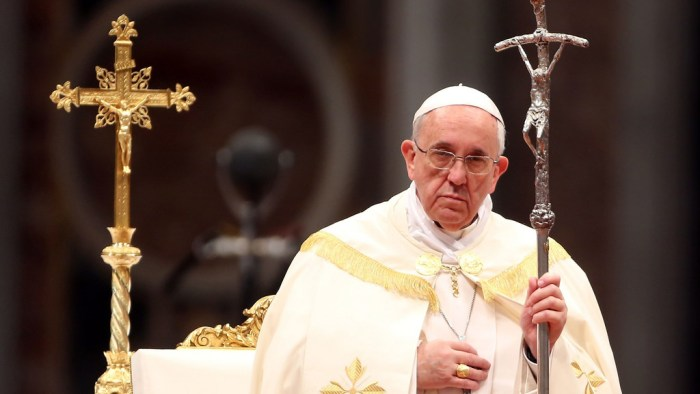 Pope holding crucifix