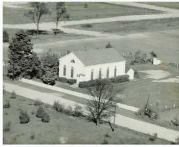 Our church building in its original location at a distance