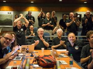 Members of the New Horizons science team reacttoseeing thespacecraft'slast and sharpestimage of Pluto before closest approach later in the day, Tuesday, July 14, 2015 at the Johns Hopkins University Applied Physics Laboratory (APL) in Laurel, Maryland. Photo Credit: (NASA/Bill Ingalls)
