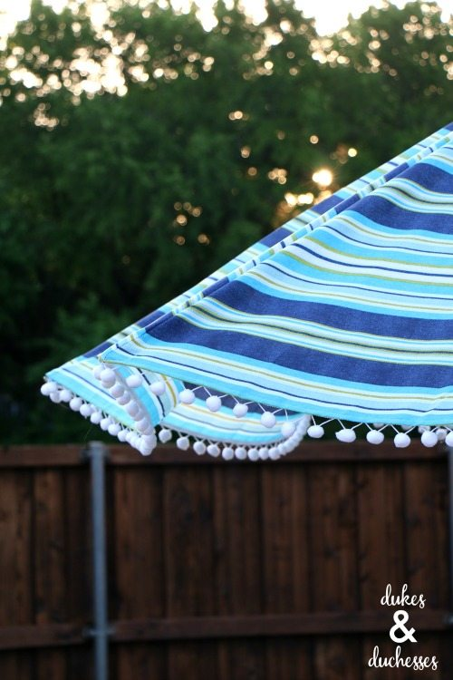 DIY-embellished-umbrella-with-pom-pom-trim