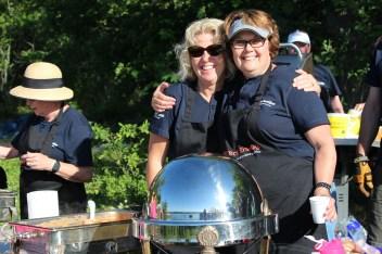 volunteers serving during Island Breakfast