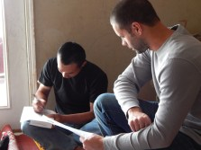 Po Khu and Caleb Benningfield sit together as Po Khu completes his worksheet. Benninfield and his wife Laura have been helping their refugee friends in many ways, but they enjoy using the Bible to inspire their English lessons. Po Khu, who is married to Ka Tay, is a Christian. They wish they could participate in church more, but language issues sometimes happen.