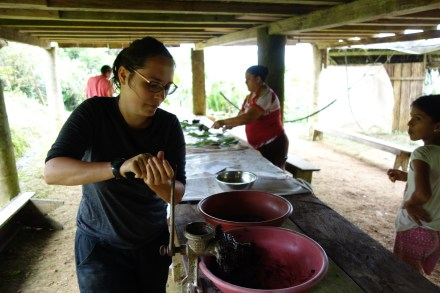 Volunteers make chocolate with Don Adrian and his family