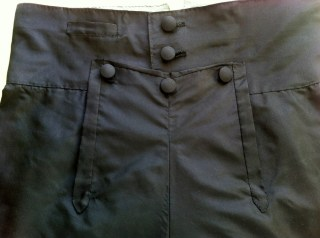 Regency breeches: Closeup on fall front, buttons, welt pocket