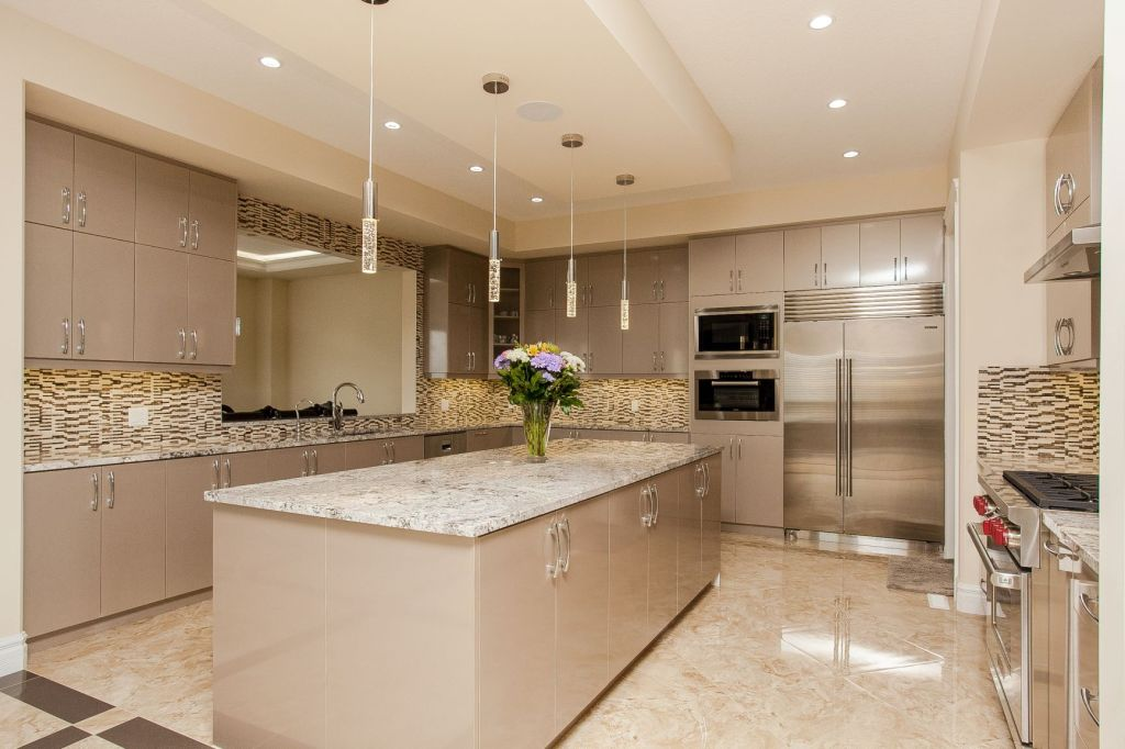 Elegant transitional high gloss beige kitchen cabinets.