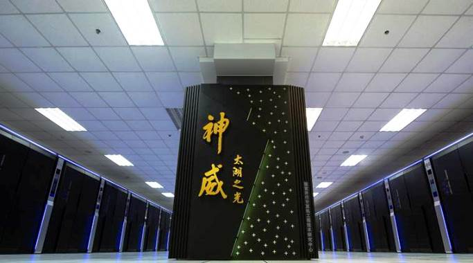 In this photo released by Xinhua News Agency and taken on June 16, 2016, the Sunway TaihuLight, a new Chinese supercomputer, is seen in Wuxi, eastern China's Jiangsu Province. A supercomputer from China has topped a global list of the fastest systems for a seventh straight year _ and for the first time the winner, Sunway TaihuLight, uses only Chinese-designed processors instead of U.S. technology. (Li Xiang/Xinhua via AP) NO SALES